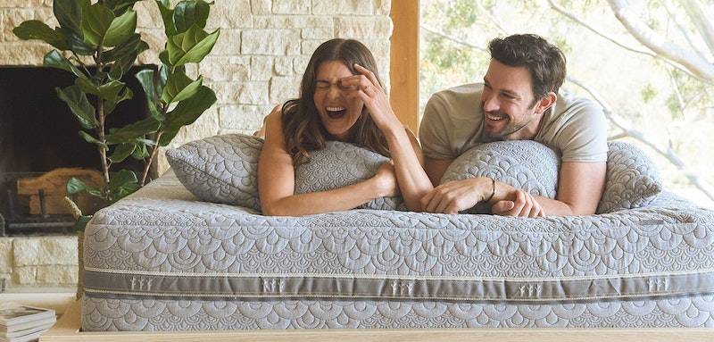 Man and woman lying on a Brentwood Home mattress