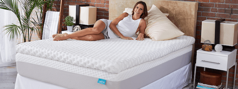 Woman lying on her side on a Luma mattress