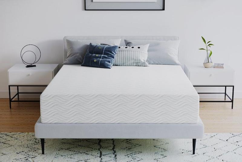 PlushBeds organic mattress in a minimalist room