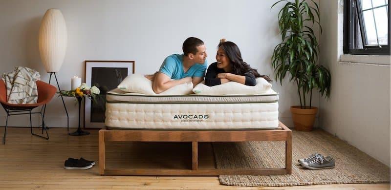 A couple (man and woman) lying on an Avocado Green Mattress