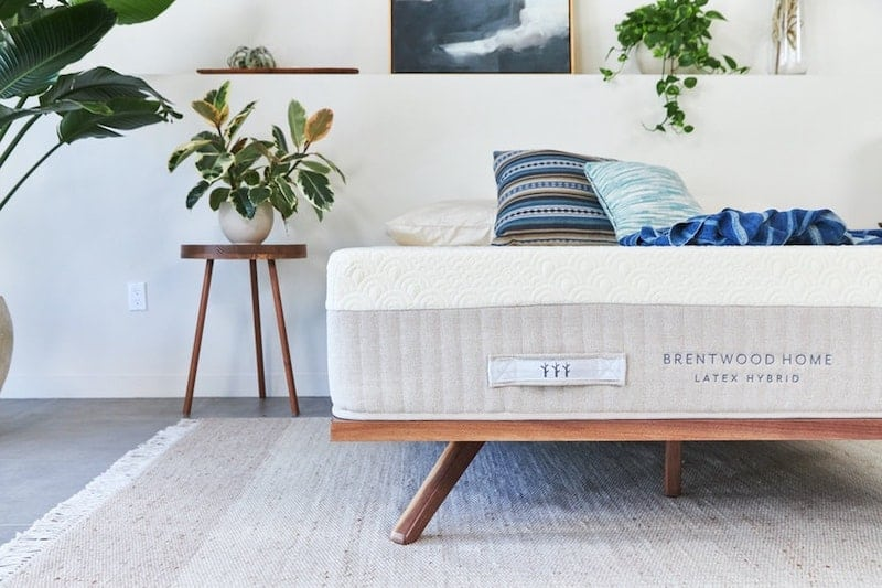 View of a bedroom with one of the affordable organic mattresses we talk about in this article