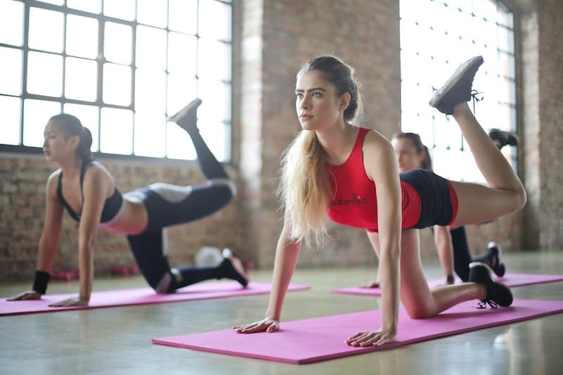 women doing yoga in a studio