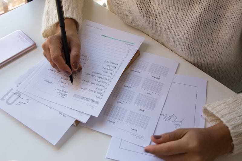 Woman writing in a planner