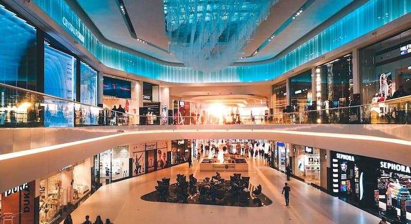 a mall, showcasing society's compulsive consumption