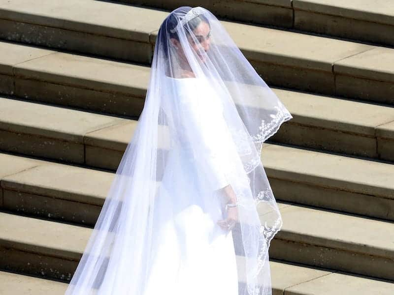 Meghan Markle in her wedding dress with a veil that isn't from an ethical wardrobe