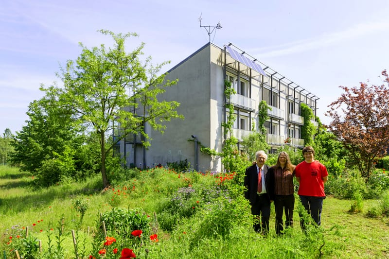 Dr. Wolfgang Feist and family pose in front of the world's first passive solar house