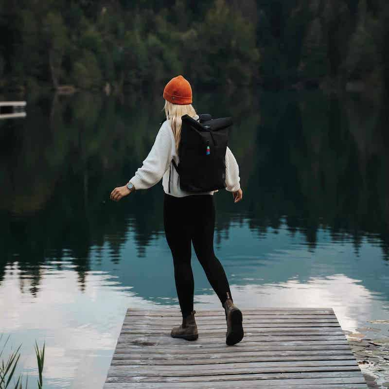 woman wearing GOT rolltop bag be the lake