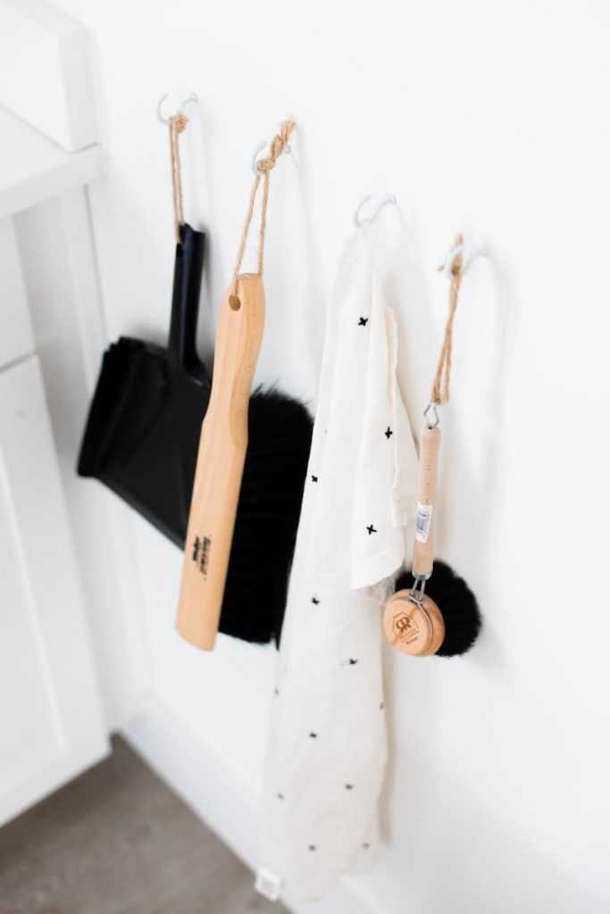 zero waste bathroom cleaning products hanging from a hook