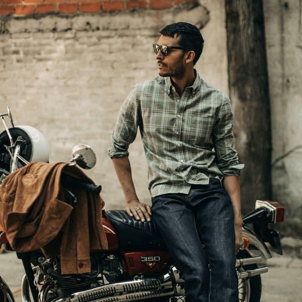 Man wearing Taylor Stitch shirt and sitting on a motorbike