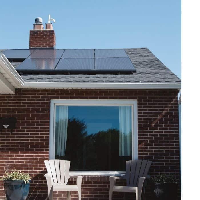 rooftop solar panels on a home can help you live a low waste lifestyle