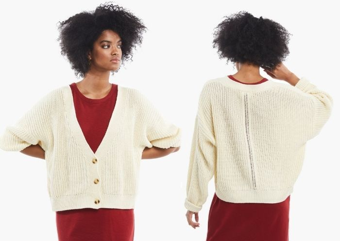 Woman wearing white ABLE fair trade sweater