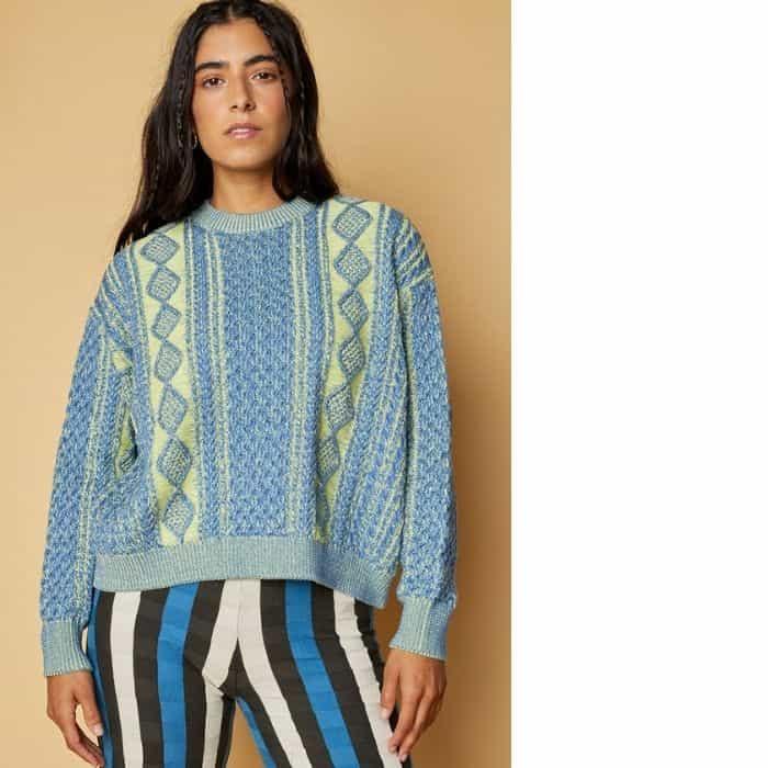 woman wearing sustainable knitwear