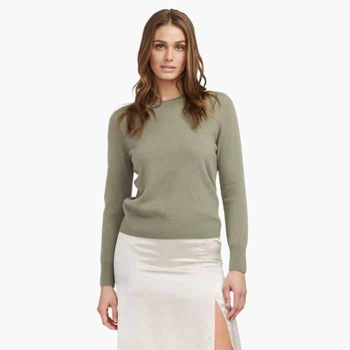 woman wearing green sweater made with fair trade wool
