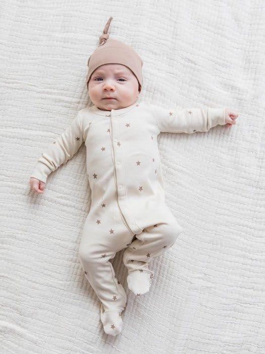 grumpy baby in colored organics baby clothing onesie