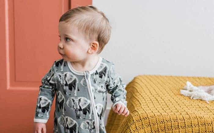 little boy wearing organic baby clothing with elephant print