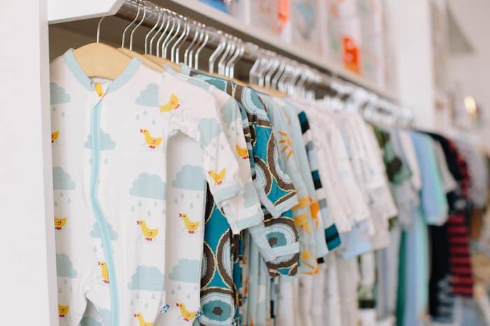 rows of organic baby clothing hanging
